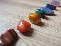 Chiuda su delle pietre di Chakra Immagini Stock