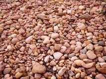 Chiuda su delle rocce sulla terra Fotografia Stock