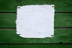 Chiuda in su di documento su priorità bassa di legno fotografia stock libera da diritti