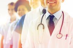 Chiuda su di medici felici con lo stetoscopio Fotografia Stock Libera da Diritti