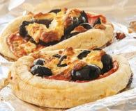 Chiuda su di mini pizze fotografie stock