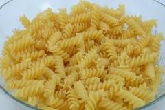 Chiuda su di pasta a spirale italiana cruda usata come fondo Immagine Stock Libera da Diritti