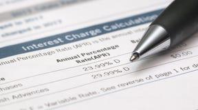 Chiuda su di Pen And Bank Statements Showing APRILE Immagine Stock