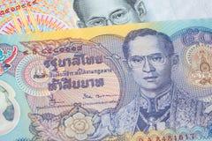 Chiuda in su di soldi tailandesi Fotografia Stock