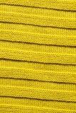 Chiuda su di tessuto giallo Immagine Stock