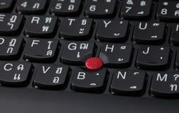 Chiuda su di un alfabeto inglese e tailandese nero della tastiera Immagine Stock Libera da Diritti