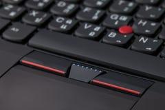 Chiuda su di un alfabeto inglese e tailandese nero della tastiera Fotografia Stock