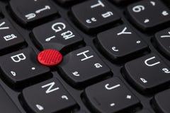 Chiuda su di un alfabeto inglese e tailandese nero della tastiera Fotografie Stock