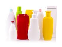 Chiuda su di un bianco e delle bottiglie colorate Fotografia Stock Libera da Diritti