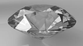 Chiuda su di un diamante su un fondo bianco Fotografie Stock