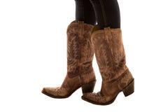 Chiuda su di un paio del fondo di bianco degli stivali di cowboy Fotografia Stock