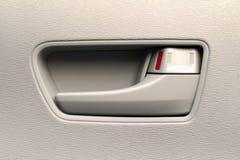 Chiuda su di una maniglia di porta interna dell'automobile Fotografia Stock