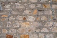 Chiuda in su di una parete di pietra Immagine Stock