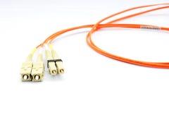 Chiuda su di una testa a fibra ottica di patchcord Fotografia Stock Libera da Diritti