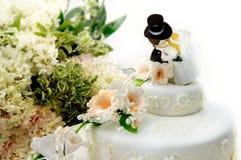 Chiuda in su di una torta di cerimonia nuziale Fotografia Stock Libera da Diritti