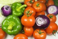 Chiuda su di varie verdure crude variopinte Immagine Stock
