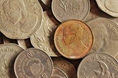 Chiuda su di vecchie monete di baht tailandese Immagini Stock Libere da Diritti