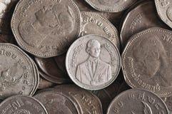 Chiuda su di vecchie monete di baht tailandese Immagine Stock Libera da Diritti