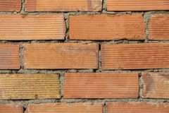 Chiuda su di vecchio fondo rosso di struttura del muro di mattoni immagini stock