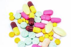 Chiuda su molti la droga su bianco Fotografie Stock