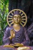 Chiuda su per la statua di Buddha fotografia stock libera da diritti
