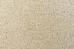 Chiuda su struttura e sul fondo della carta marrone con spazio fotografia stock