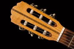 Chiuda su su una chitarra classica fatta di legno Fotografia Stock Libera da Diritti