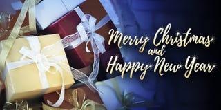 Chiuda su sui presente del nuovo anno e di Natale Immagine Stock Libera da Diritti