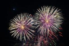 Chiuda sui fuochi d'artificio con la luna nei precedenti Immagine Stock Libera da Diritti