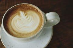Chiuda sul caffè del latte immagini stock