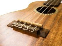 Chiuda sul colpo del ponte delle ukulele Immagini Stock
