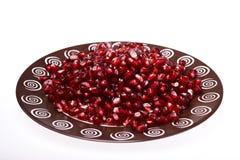 Chiuda sul colpo a macroistruzione dei semi del melograno Immagine Stock