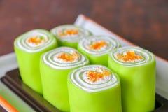 Chiuda sul dolce verde del rotolo Immagine Stock
