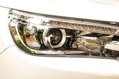 Chiuda sul faro di un'automobile Immagine Stock Libera da Diritti