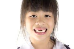 Chiuda sul mese del bambino con i denti mancanti Immagini Stock Libere da Diritti