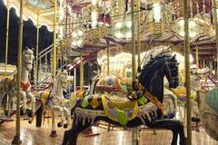 Chiuda sul punto di vista dei cavalli di un carosello Fotografia Stock Libera da Diritti