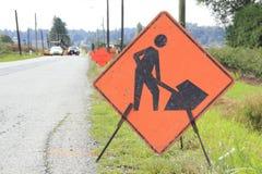 Chiuda sul segno della costruzione di strade Immagini Stock Libere da Diritti