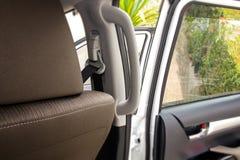 Chiuda sulla maniglia interna dell'automobile Immagini Stock