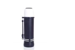 Chiuda sulla nuova boccetta nera del termos isolata su bianco Fotografia Stock