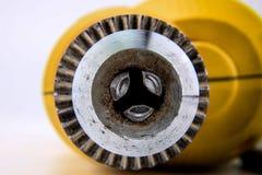 Chiuda sulla perforatrice gialla Fotografia Stock