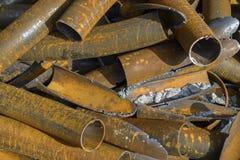 Chiuda sulla pila del metallo dei tubi Immagini Stock