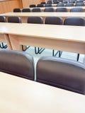 Chiuda sulla sedia vuota nell'auditorium Fotografia Stock Libera da Diritti