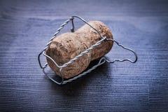 Chiuda sulla vista su corck di champagne con cavo Fotografia Stock