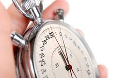 Chiuda sulla vista sulle mani del cronometro Fotografie Stock
