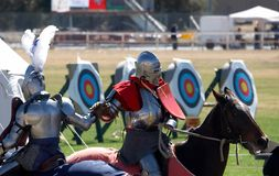 Chivalry. Two knights clasping hands after a joust Royalty Free Stock Images