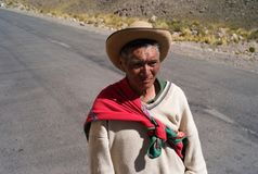 Peruvian Farmer Walking Along a Lonely Mountain Road royalty free stock photography