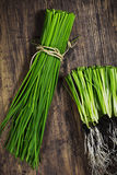 Chive. Fresh Bunch of Chive on Rustic Cutting Board. Shallow Depth of Field Royalty Free Stock Images