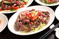 Chive fried beef with chili and onion on white plate in restaura Stock Photos