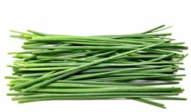 Chive leaves. Stacked next to each other surrounded by white background stock photos