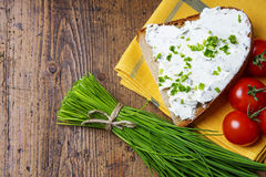Fresh chives and a bread with cottage cheese Royalty Free Stock Images